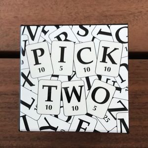 Free with any purchase.Pick two crossword unopened